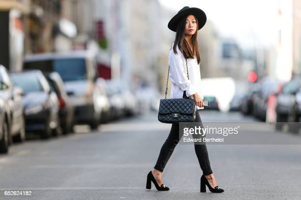 May Berthelot Head of Legal at Videdressingcom and fashion blogger wears a Newlook hat Newlook black denim jeans pants Newlook black shoes an Ivy...