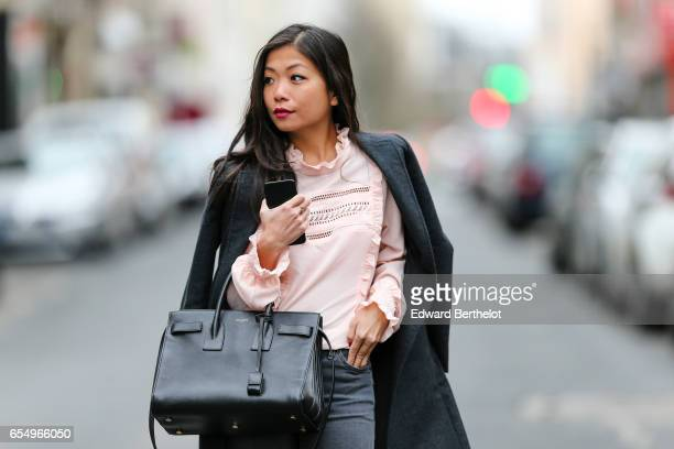 May Berthelot Head of Legal at Videdressingcom and fashion blogger wears a Lovie and Co pink lace blouse top a tailored wool trench coat Topshop gray...