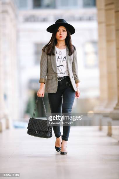May Berthelot Head of Legal at Videdressingcom and fashion blogger wears a New Look black hat New Look black denim jeans a Chanel graffiti tshirt a...