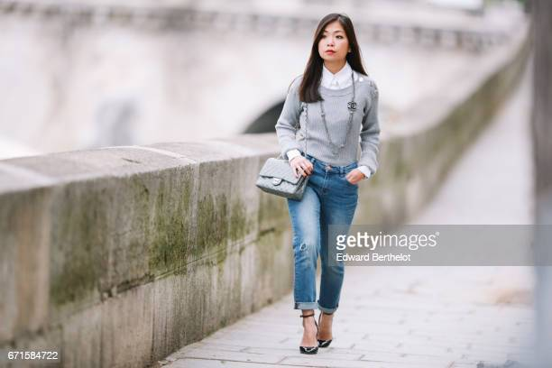 May Berthelot Head of Legal at Videdressingcom and fashion blogger wears a Chanel white shirt a Balzac gray knit sweater The Kooples jeans Valentino...