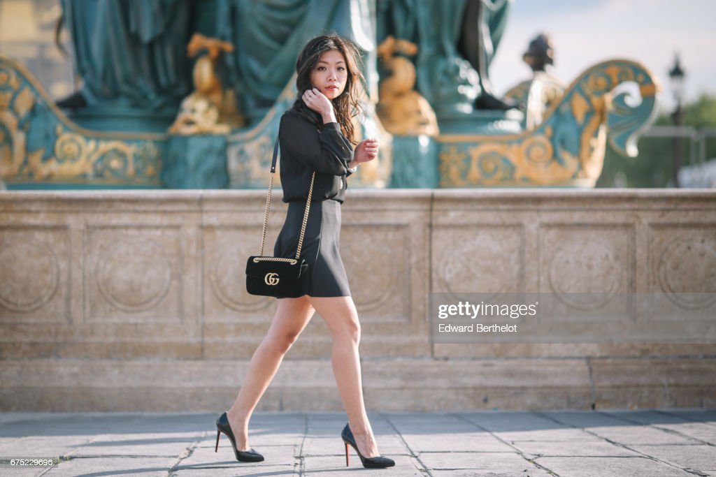May Berthelot, Head of Legal at Videdressing.com and fashion blogger, wears a Harpe black meshed blouse, a Topshop ruffled black skirt, Louboutin Pigalle Plato shoes, a Gucci Marmont black velvet bag, a Dior necklace, and a Delphine Pariente necklace, at Place de la Concorde, on April 29, 2017 in Paris, France.