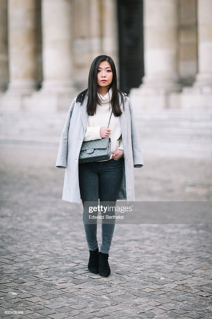 May Berthelot, Head of Legal at Videdressing.com and fashion blogger, is wearing a Chanel sweater, Topshop gray denim jeans, Zara black suede boots, a Newlook gray coat, and Chanel gray timeless bag, during Paris Fashion Week Menswear Fall/Winter 2017/2018, on January 22, 2017 in Paris, France.