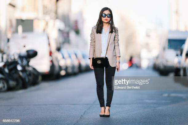 May Berthelot Head of Legal at Videdressingcom and fashion blogger wears black shoes New Look pants a Topshop blue shirt an Asos beige blazer jacket...