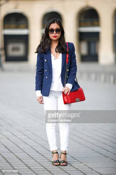 May Berthelot, Head of Legal at Videdressing.com and fashion blogger, wears Saint Laurent YSL sunglasses, a Chanel Boy red bag, a Zara white blouse,...
