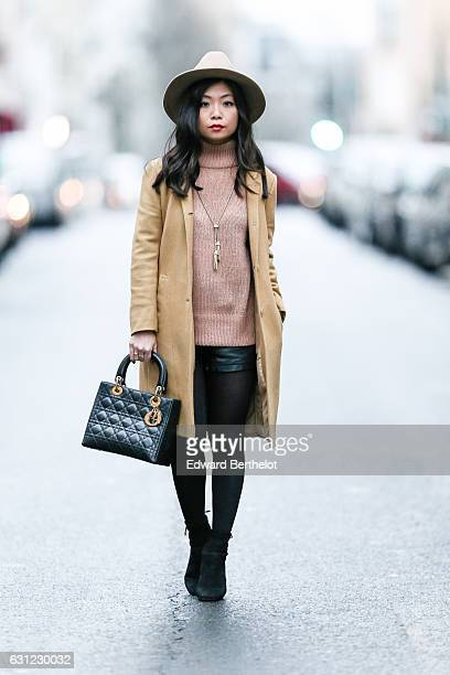 May Berthelot Head of Legal at Videdressingcom and influencer is wearing a The Kooples hat a beige camel long coat designed by herself a New Look...