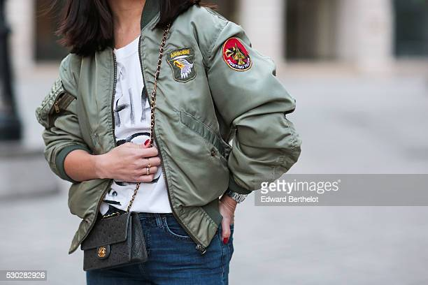 May Berthelot is wearing a green vintage bomber jacket a Chanel white tshirt Top Shop blue jeans a green Chanel bag in ostrich leather boots Merli by...