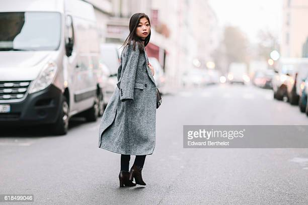 May Berthelot is wearing a Marks and Spencer gray oversized coat Marks and Spencer brown boots a Marks and Spencer gray cashmere sweater an Asos...