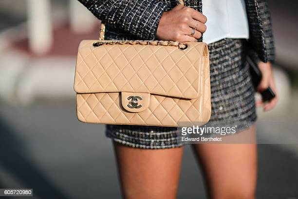 May Berthelot is wearing a tailored suit designed by May Berthelot a Sandro silk white top a Chanel timeless beige bag Zara beige shoes and...