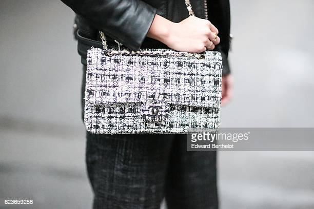 May Berthelot is wearing a The Kooples black leather jacket a Courreges white turtleneck top Chanel tweed pants a Chanel white tweed bag and Zara...