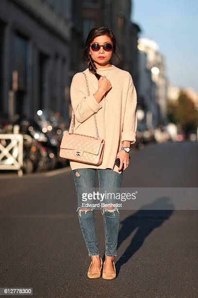May Berthelot is wearing a Topshop sweater a Chanel timeless bag Zara slingbacks shoes Topshop ripped jeans and Tijn sunglasses during Paris Fashion...