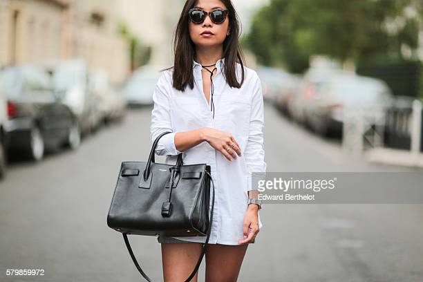 May Berthelot is wearing a Topshop white shirt Asos sandals shoes Triwa sunglasses a Cartier Pasha watch a Saint Laurent black bag and an Asos...