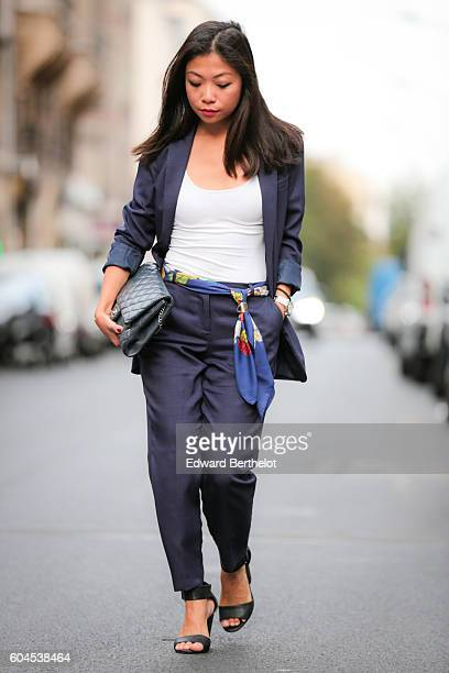 May Berthelot is wearing an Asos dark blue suit a Chanel blue timeless bag a Hermes ring a Hermes scarf and HM sandals on September 13 2016 in Paris...