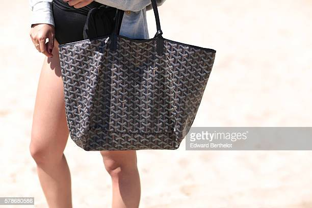 May Berthelot is wearing an Asos shirt an Asos black swim suit a Goyard St Louis bag and Triwa sunglasses on the beach on July 22 2016 in Royan France