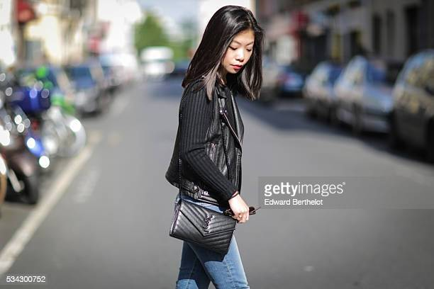 May Berthelot is wearing an Iro sleeveless black leather jacket The Kooples blue jeans Zara black leather boots a Chanel cachemire black body top and...