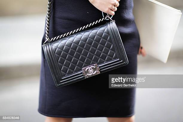 May Berthelot , is wearing Darris yellow clutch bag, an Iris Cantabri dress, a black Chanel Boy bag, and Asos sandals, during a street style session,...