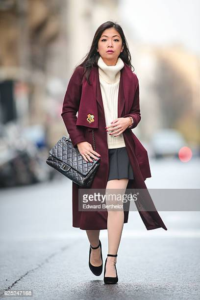 May Berthelot , is wearing New Look babies shoes, a Topshop skirt, New Look purple burgundy coat, a Chanel 2.55 black bag, Chanel bicolor tights with...
