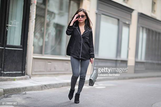 May Berthelot wears a Zara pajama shirt Topshop Petite jeans Saint Laurent low boots and sunglasses and a Chanel timeless bag during a street style...