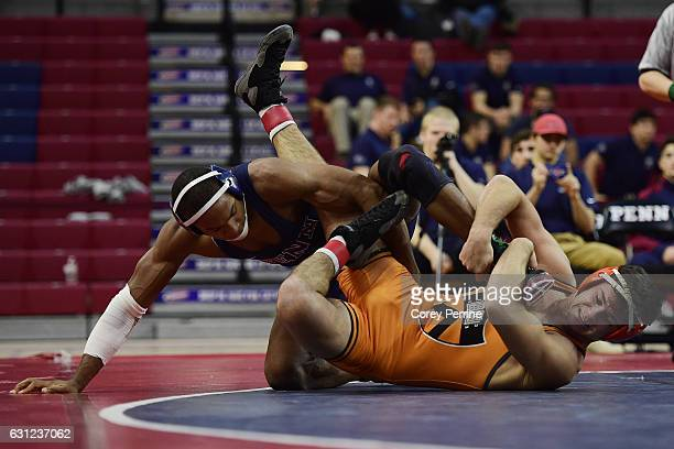 May Bethea of the Pennsylvania Quakers tries to turn Mike D'Angelo of the Princeton Tigers for back points at The Palestra on January 8 2017 in...