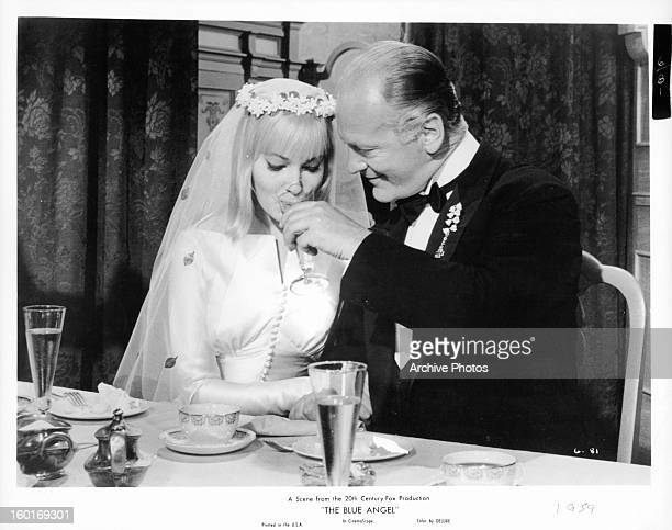 May Britt sits with her new husband Curd Jürgens in a scene from the film 'The Blue Angel' 1959