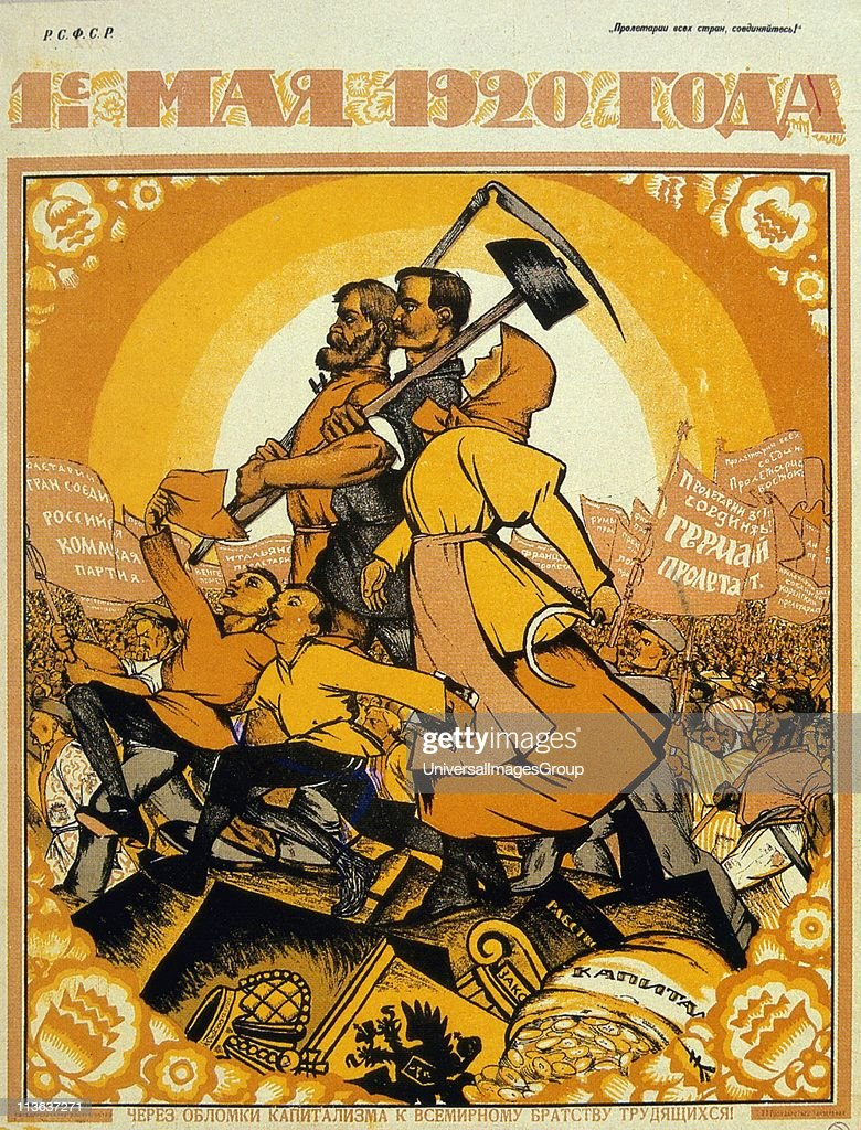 May Day 1920. On the ruins of capitalism the fraternity of peasants and workers marches against the peoples of the world. Artist, Nicolas Kotcherguine. Soviet Social Realism. : News Photo