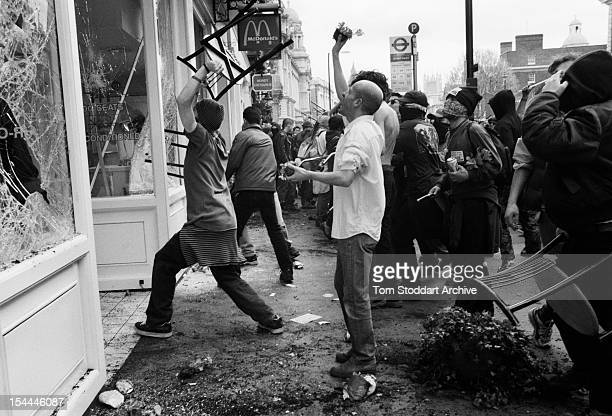 May Day anticapitalist demonstrators attack a McDonald's fast food restaurant near Trafalgar Square during anticapitalist protests which caused...