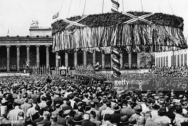 May Day celebration in Berlin Civilians gathered at the Lustgarten in Berlin listening to Adolf Hitler's speech In the middle the mast with foliage...
