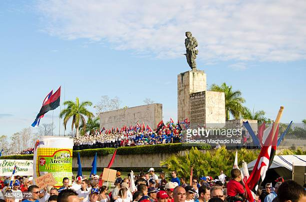 May Day celebration in the Che Guevara square in Santa Clara Hundreds of people wave Cuban flags in celebration under the watchful eye of a statue of...