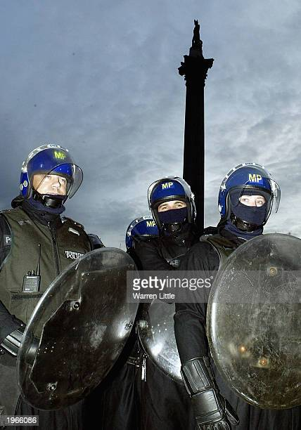 may day demonstrations in london - riot shield stock pictures, royalty-free photos & images