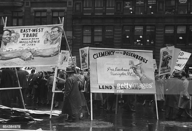 May Day demonstrators in Union Square New York with a poster calling on US President Dwight D Eisenhower to show clemency to American couple Julius...