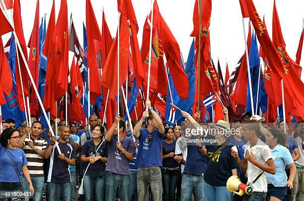 CONTENT] May day Havana Crowd carrying large flags at Plaza de la Revolución May Day parade