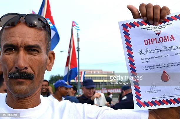 CONTENT] May day HavanaCuban man holding his Diploma at Plaza de la Revolución