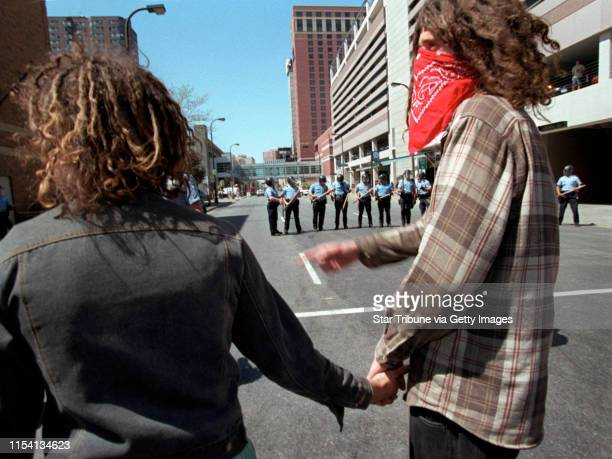 May Day Protest To be young anarchist and in love these days may involve protesting together as this hand holding couple did during the May Day...
