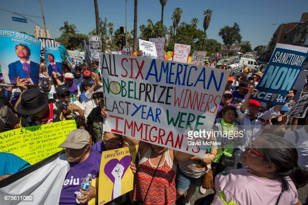 May Day protesters march to City Hall on May 1 2017 in Los Angeles California Numerous May Day rallies and protests triggered by controversies...