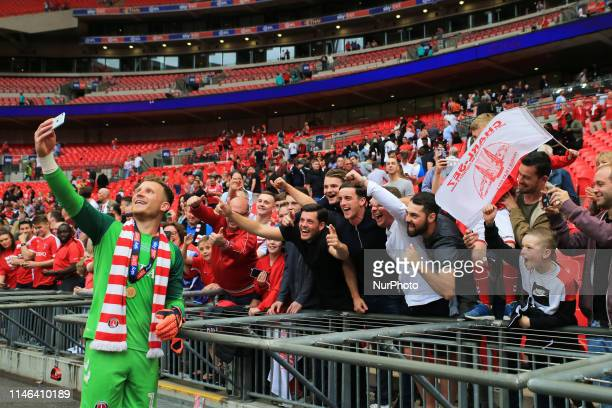 May Dillon Phillips of Charlton Athletic celebrates with fans during the Sky Bet League 1 Play off Final between Charlton Athletic and Sunderland at...