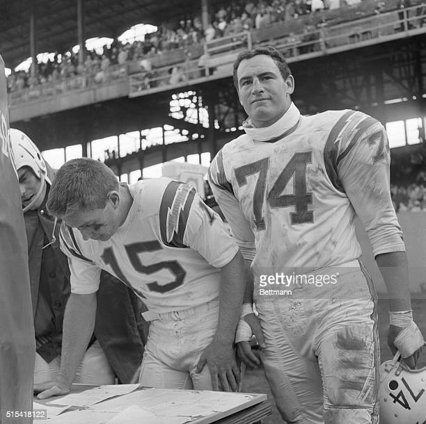 """May Exchange Uniforms. New York: San Diego Chargers Jack Kemp, , and Ron Mix, display that """"in-the-same-boat"""" look before game with the New York..."""