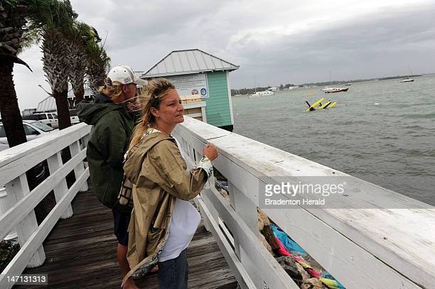 May Galloway and Jeremy Thomas look out over the waters off the Bridge Street Pier in Manatee County, Florida on June 25, 2012. The couple's home, a...