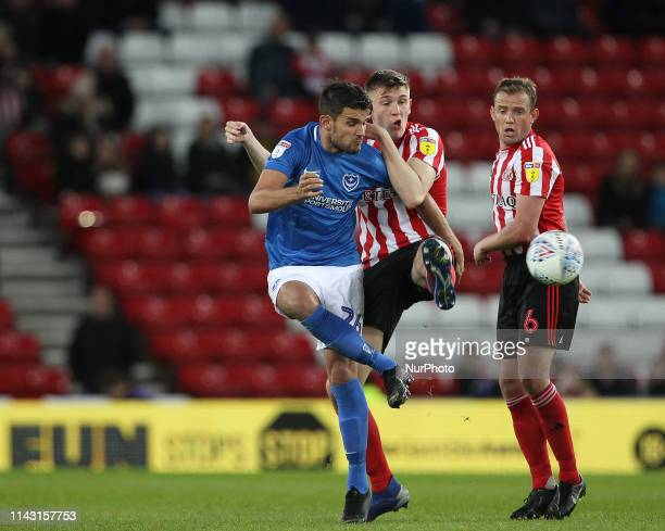 May Gareth Evans of Portsmouth battles with Jimmy Dunne and Lee Cattermole of Sunderland during the Sky Bet League 1 Play off Semi Final 1st Leg...