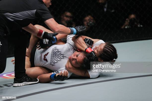May Ooi chokes out Vy Srey Khouch at ONE Championship Immortal Pursuit at the Singapore Indoor Stadium on November 24 2017 in Singapore Singapore