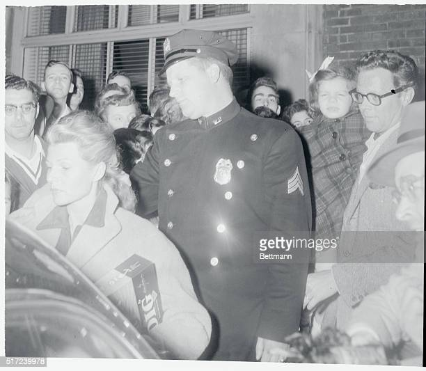 May Reach Settlement White Plains New York Screen actress Rita Hayworth walks from a hotel in White Plains with husband Dick Haymes who holds...