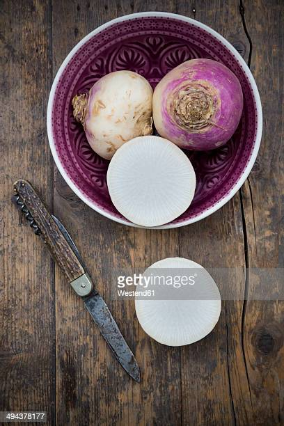 may turnip (brassica rapa ssp. rapa var. majalis) in a bowl and on wooden table - turnip stock pictures, royalty-free photos & images