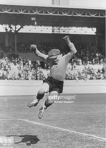 The Belgian goalkeeper airborne during the match between Belgium and Argentina in the Football event at the 1928 Olympic Games in Amsterdam,...