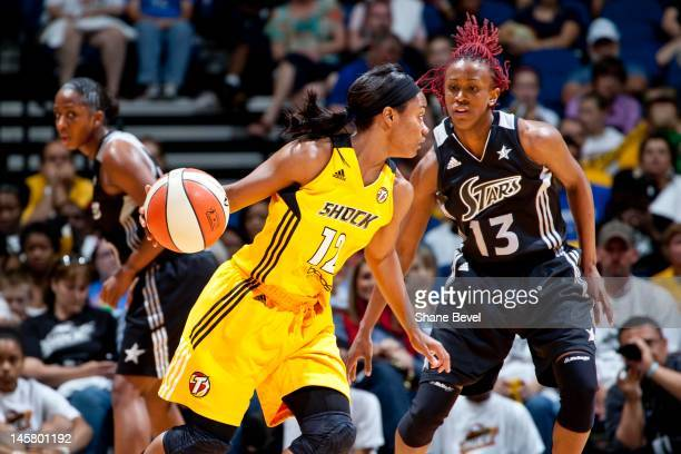 Danielle Robinson of the San Antonio Silver Stars defends against Ivory Latta of the Tulsa Shock during the WNBA game on May 19 2012 at the BOK...