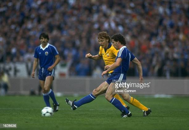 Boniek of Juventus and Magalhaes of Porto chase the ball during the European Cup Winners Cup final at the St. Jakob Stadium in Basle, Switzerland....