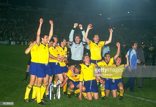 The Juventus team pose with the trophy after their victory in the European Cup Winners Cup final against Porto at the St. Jakob Stadium in Basle,...