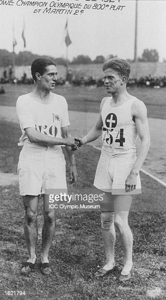 Douglas Lowe of Great Britain shakes hands with Paul Martin of Switzerland after the 800 metres event at the 1924 Olympic Games in Paris Lowe won the...