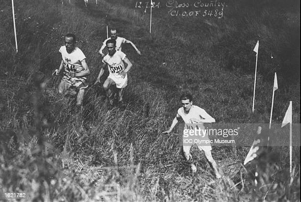 Paavo Nurmi of Finland is followed by Edvin Wide of Sweden and Vilho Ritola of Finland during the Individual Cross Country event at the 1924 Olympic...