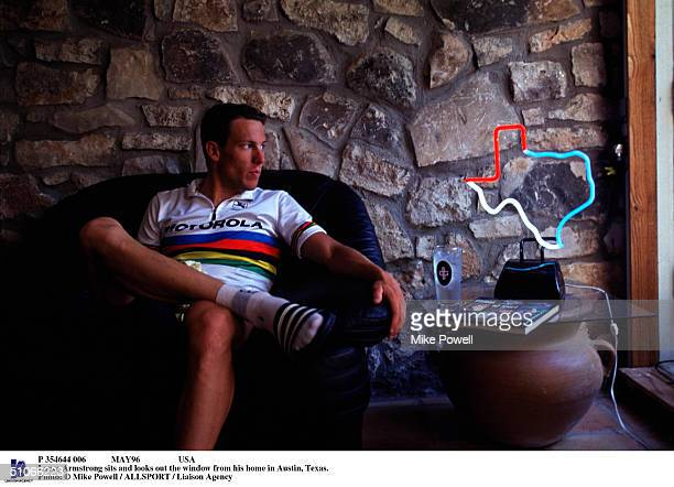 May96 Usa Lance Armstrong Sits And Looks Out The Window From His Home In Austin Texas