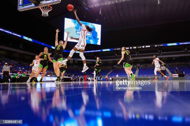 Maya Caldwell of the Georgia Lady Bulldogs drives to the basket over Erin Boley of the Oregon Ducks during the first half in the second round game of...
