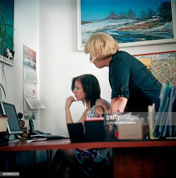 Maya Cherkova the Agency founder and owner assists one of her clients Tatyana Berchichkaya during the Skype date she is having with a man from the...