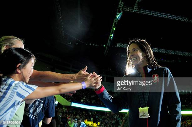 Maya DiRado of the United States greets fans following an award ceremony for the Women's 200 Individual Medley during Day Four of the 2016 US Olympic...